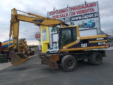 Bager CAT M318, letnik 2001